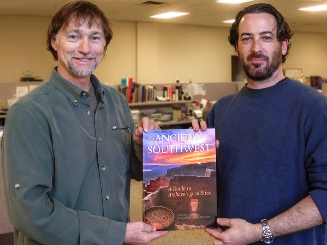"Larry Lindahl and Aaron Downey show-off the newly released ""The Ancient Southwest: A Guide to Archaeological Sites"""